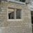 Natural stone front elevation with stone mullion window
